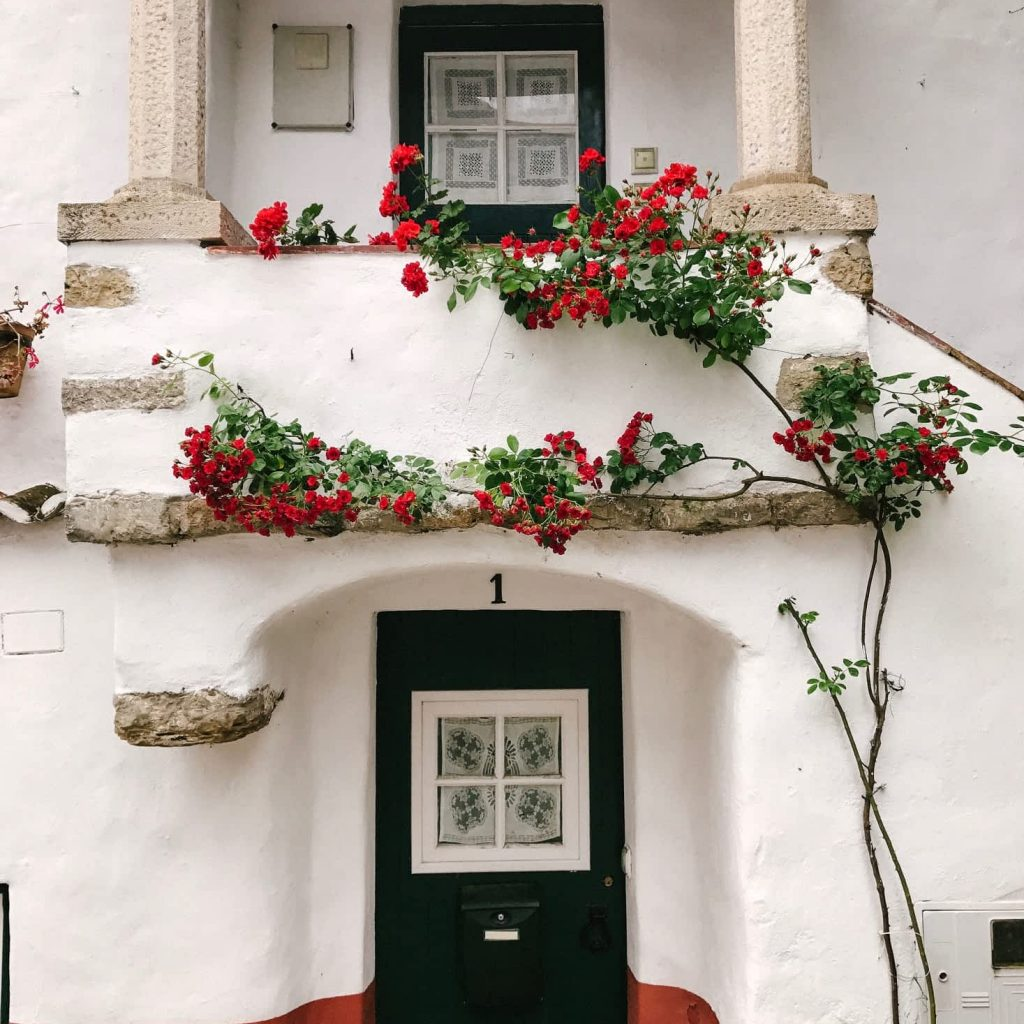 Red and white doorway in Obidos