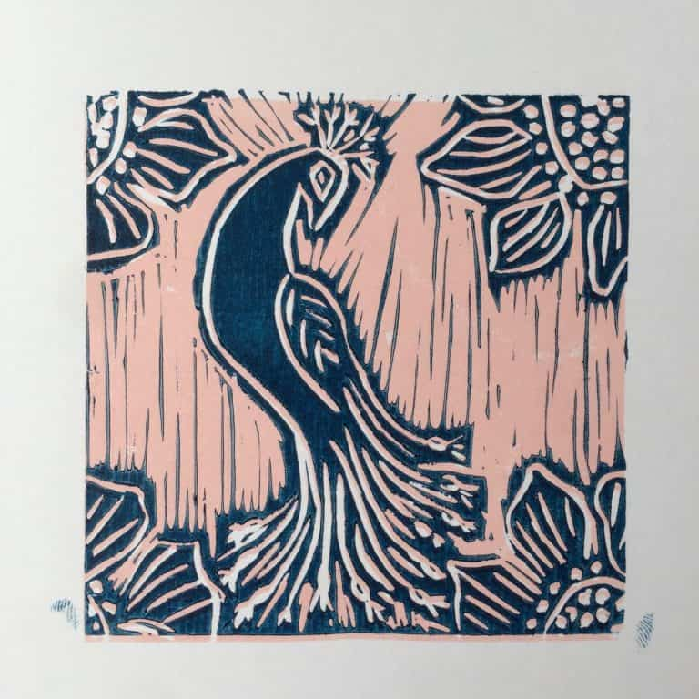 Tile print of a peacock at Lisboa Social Press