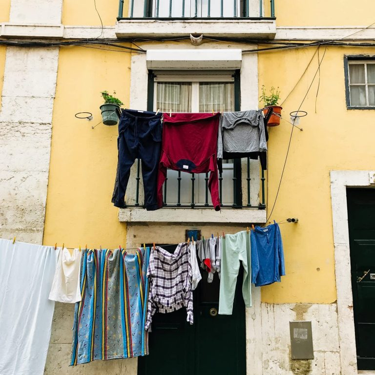 A yellow Alfama house with washing hanging outside