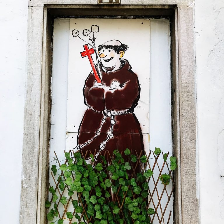 A street art image of Saint Anthony in Alfama, Lisbon