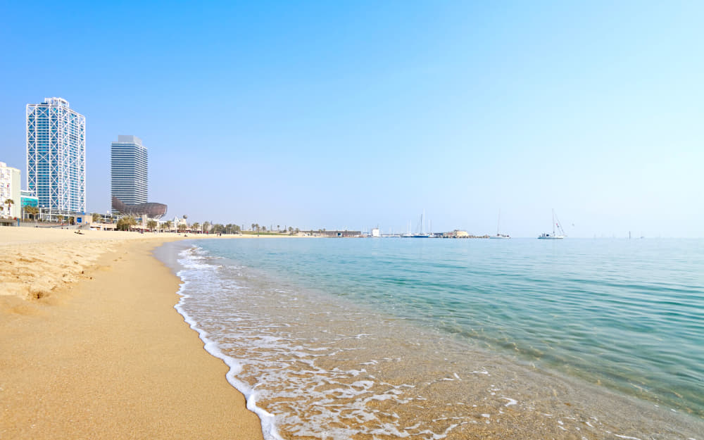 Barcelona beach - © Image Courtesy of rusm from Getty Images Signature by Canva