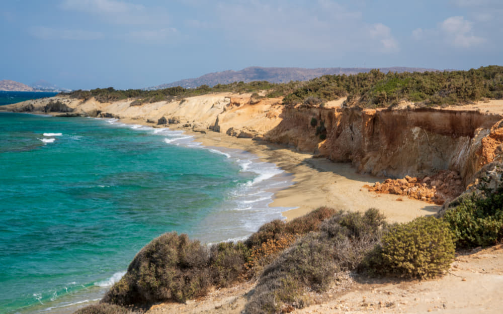 Alyko Beach - Naxos Beaches © Image Courtesy of Artur Kiss from Getty Images by Canva