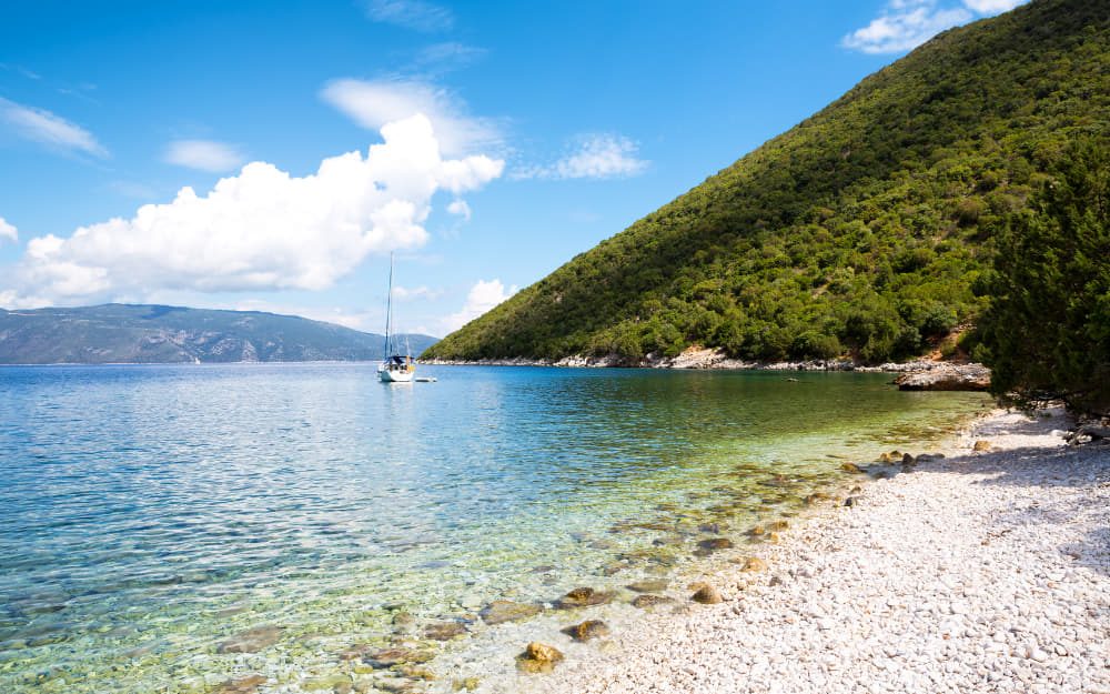 Antisamos Beach © Image Courtesy of borchee from Getty Images Signature by Canva