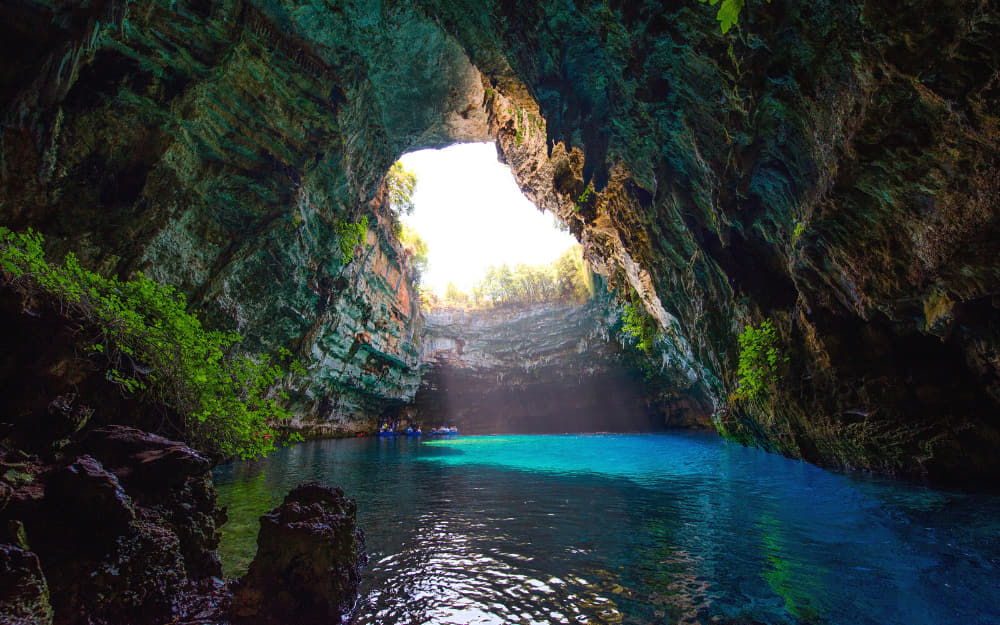 Melissani Lake © Image Courtesy of Piotr Krzeslak from Getty Images by Canva
