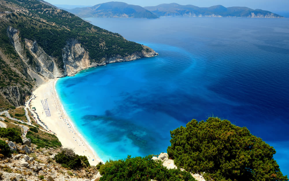 Myrtos Beach Kefalonia © Image Courtesy of C0rnholio from Getty Images by Canva