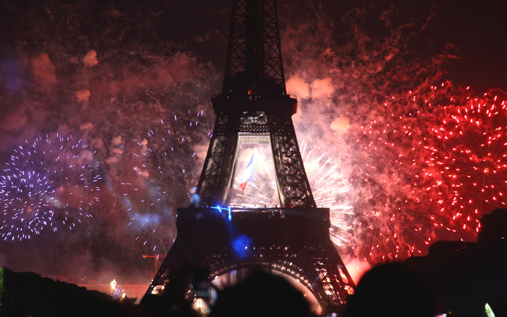 Bastille Day Fireworks in Paris - Festivals in France © Image Courtesy of Sergii Rudiuk from Getty Images by Canva