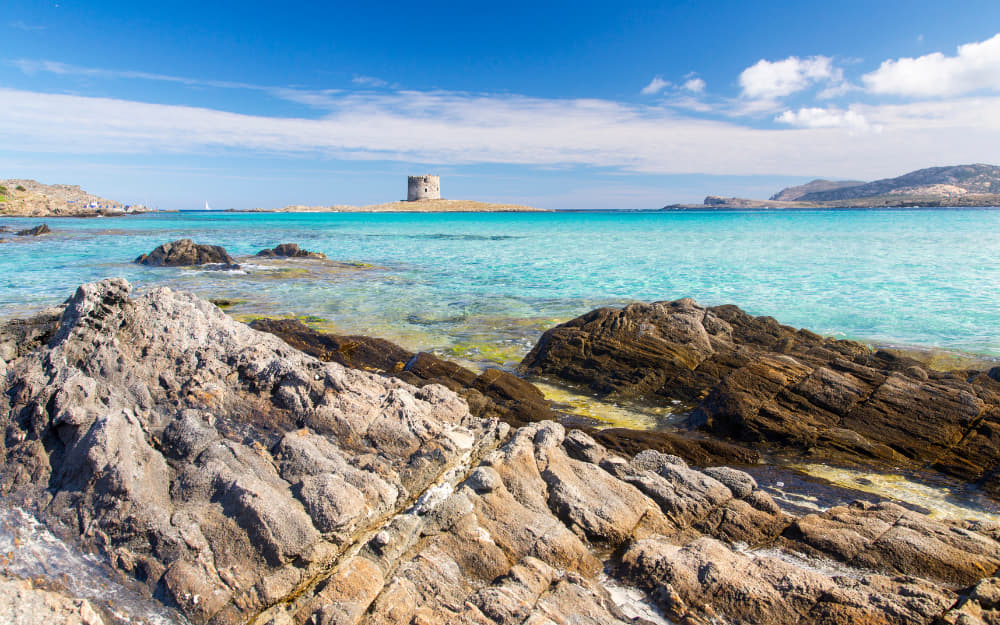 La Pelosa Beach - Sardinia Beaches © Photo by Alessandro Lai from Getty Images by Canva