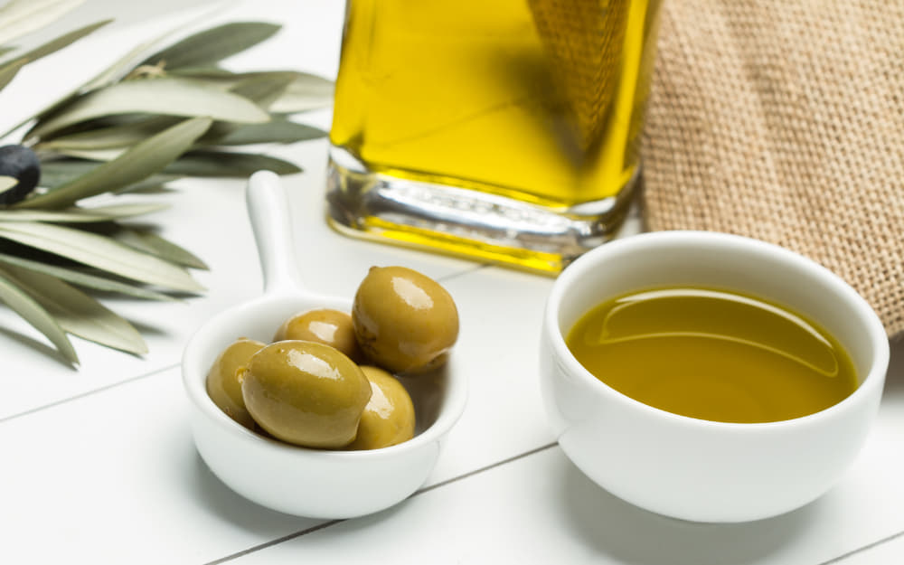 Spanish Olive Oil - © Image Courtesy of Augustin Vai from Getty Images by Canva