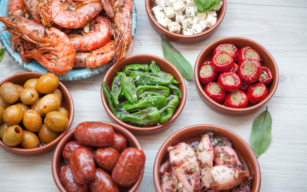 Tapas Dishes - © Image Courtesy of Maica from Getty Images Signature by Canva